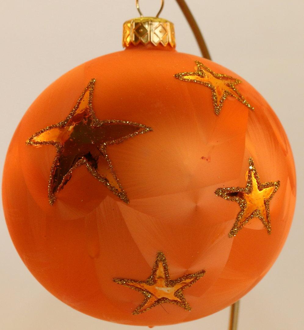 orangefarbene weihnachtskugeln mit goldenen sterne aus glas. Black Bedroom Furniture Sets. Home Design Ideas